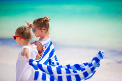 Little girls having fun running with towels on tropical beach Royalty Free Stock Photography