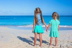 Little girls having fun during tropical beach Stock Photos