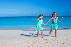 Little girls having fun during tropical beach Stock Image