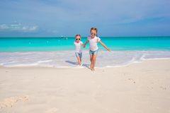 Little girls having fun during tropical beach Royalty Free Stock Photos