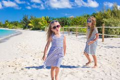Little girls having fun during tropical beach Royalty Free Stock Photography