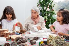 Free Little Girls Having Fun While Making Christmas Nativity Crafts With Their Grandmother Royalty Free Stock Photos - 164287498