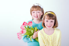 Little girls holding bouquet of tulips Stock Photos