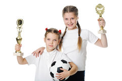 Little girls holding football ball. And trophy isolated on white Stock Images