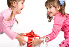 Little girls holding gift boxes Stock Images