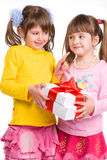 Little girls holding gift boxes Royalty Free Stock Image