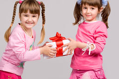 Little girls holding gift boxes Stock Image