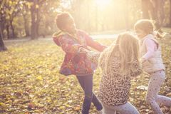 Little happy girls in park. stock photography