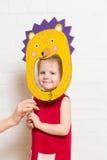 Little girls holding hedgehog mask on white background Stock Image