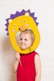 Little girls holding hedgehog mask on white background Royalty Free Stock Photos