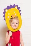 Little girls holding hedgehog mask on white background Royalty Free Stock Photo