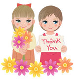Little girls holding thank you sign and flowers Royalty Free Stock Image
