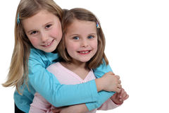 Little girls hugging Stock Photography
