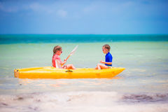 Little girls kayaking in turquoise water in the sea alone Royalty Free Stock Photography