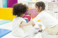 Little girls in the kindergarten stock photography
