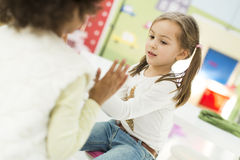 Little girls in the kindergarten stock photos