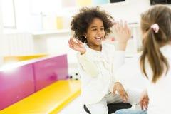 Little girls in the kindergarten stock image