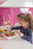 Little girls in kitchen Stock Image