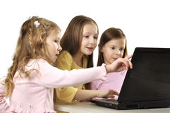 Little girls with laptop Royalty Free Stock Photos