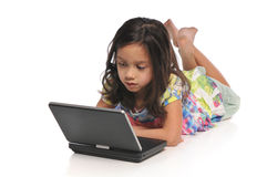 Little girls with a laptop computer Royalty Free Stock Images