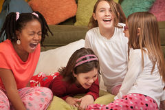 Little Girls Laugh. Group of four girls at a sleepover laugh out loud Royalty Free Stock Photos