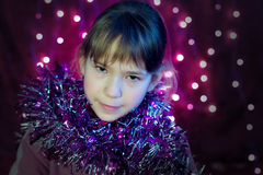 Little girls look with Christmas lights Royalty Free Stock Photos