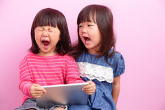 Little girls looking front together Stock Photography