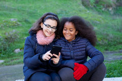 Little girls looking at the mobile Royalty Free Stock Photo