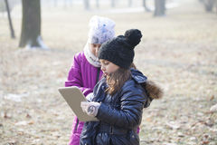 Little girls looking at tablet Royalty Free Stock Photography