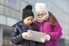 Little girls looking at tablet Royalty Free Stock Images
