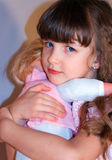 Little girls love dolls Royalty Free Stock Photography