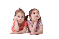 Little girls lying on the floor royalty free stock image
