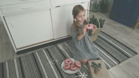 Little girls make dough, bake cookies in the kitchen. Happy children in the kitchen. Dough and cookies. Cook donuts stock video footage