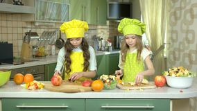 Little girls making salad. stock video footage