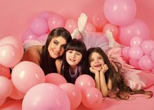 Little girls, mom in pink balloons. Family, children, mother with party balloons. Birthday, happiness, childhood. Mother and kids in balloons, mothers day royalty free stock photos