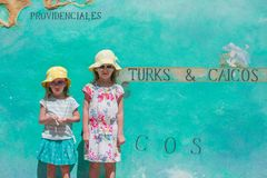 Little girls near big map of Caribbean island Royalty Free Stock Photos