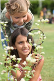 Little girls observing flowers Stock Images