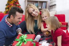 Little girls opening presents. Look! What is inside the gift box Royalty Free Stock Images