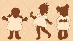 Little girls on the ornate background. Vintage silhouette of little girls on the ornate background Royalty Free Stock Photos
