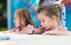 Little girls painting . Royalty Free Stock Photography