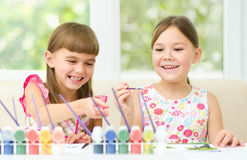 Little girls are painting with gouache Stock Photo