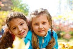 Little girls in  park Stock Photos