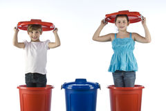 Little girls in a plastic drums Royalty Free Stock Image
