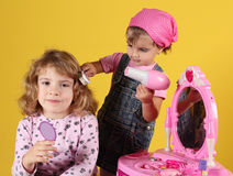 Little girls play hairdressers Royalty Free Stock Image