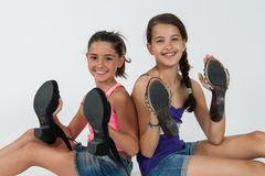 Little girls play with mom's shoes Stock Images