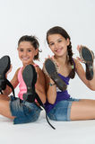 Little girls play with mom's shoes Royalty Free Stock Photography