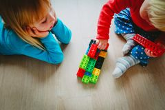 Kids play with plastic blocks, learning concept. Little girls play with plastic blocks, learning concept stock images