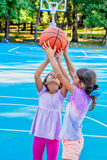 Little girls playing basketball. Seven year old girls are playing basketball stock images