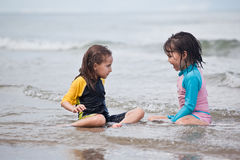 Little girls playing on the beach, family beach vacation Royalty Free Stock Images