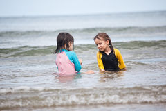 Little girls playing on the beach, family beach vacation Royalty Free Stock Photos